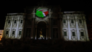 The logo for the candidacy of Rome for the 2024 Olympic games is projected on the Trevi's fountain in Rome, on  Dec. 14, 2015. (Gregorio Borgia / AP)