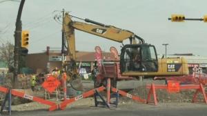 61 Ave SW road repairs