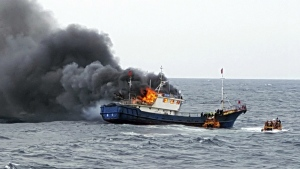 A Chinese fishing boat catches fires during an inspection by the South Korean coast guard in the water off Hong Island, South Korea on Thursday, Sept. 29, 2016. (South Korean Mokpo Coast Guard)