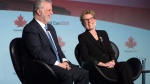 Ontario Premier Kathleen Wynne, right, and Quebec Premier Philippe Couillard share a laugh during a panel discussion in Ottawa, On Friday November 20, 2015. THE CANADIAN PRESS/Adrian Wyld