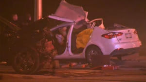 Significant damage to a black Dodge Journey and a white Kia Forte following Sunday morning's fatal crash