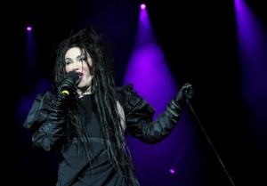 In this file photo dated Dec. 21, 2012, showing singer of the band Dead or Alive, Pete Burns in concert in London. Burns died on Sunday Oct. 23, 2016, after suffering a cardiac arrest, according to a statement from his management. (Ian West / PA FILE via AP)
