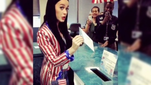 Katy Perry rocks a red white and blue suit jacket as she promotes early voting.