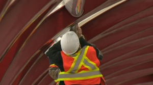 City crews are replacing all 300 of the Peace Bridge's lighting fixtures with LED lights which can manage more easily in Calgary's cold winters.