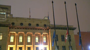 Flags are seen at half-mast at Calgary's McDougall Centre on October 28, 2016, in memory of former Premier Jim Prentice.