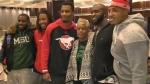 Renee Hill and members of the Calgary Stampeders