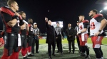 Gov.-Gen. David Johnston does the traditional pre-game coin flip before CFL Grey Cup game action, Sunday, November 27, 2016 in Toronto. (/Nathan Denette / THE CANADIAN PRES)