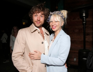 In this Aug. 7, 2014 file photo, filmmaker Erik Anders Lang, left, and singer Sia attend the after party for the premiere of 'The One I Love,' in Los Angeles. (Photo by Todd Williamson / Invision / AP)