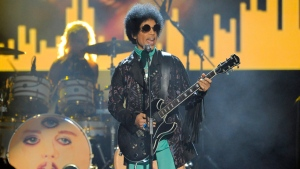 FILE - In this May 19, 2013 file photo, Prince performs at the Billboard Music Awards at the MGM Grand Garden Arena in Las Vegas. (Photo by Chris Pizzello/Invision/AP, File)
