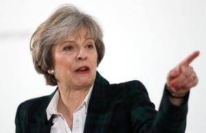 Britain's Prime Minister Theresa May gestures as she delivers a speech on leaving the European Union at Lancaster House in London, Tuesday, Jan. 17, 2017. (AP Photo/Kirsty Wigglesworth, pool)
