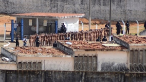 Inmates stand surrounded by police after a deadly prison riot at the Alcacuz prison in Nisia Floresta, Rio Grande do Norte state, Brazil, on  Jan. 15, 2017. (Frankie Marcone / Futura Press)