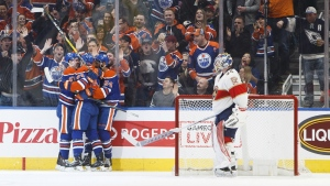 Edmonton Oilers' Connor McDavid, Zack Kassian and Jujhar Khaira celebrate a goal as Florida Panthers goalie James Reimer looks on during first period NHL action in Edmonton, Alta., on Wednesday, Jan. 18, 2017. (Jason Franson / THE CANADIAN PRESS)
