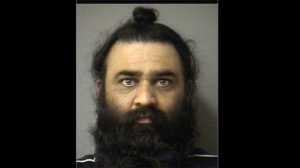 Police released this photo of Darshan Dhaliwal, a Brampton man charged with defrauding a woman in a 'spiritual scam.'