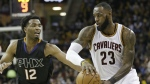 Cleveland Cavaliers' LeBron James passes against Phoenix Suns' TJ Warren in the second half of an NBA basketball game in Cleveland on Thursday, Jan. 19, 2017. (AP / Tony Dejak)
