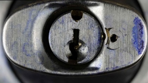 A photo of the side door lock taken from the Liknes home was shown during the Garland murder trial on January 19, 2017.