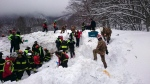 Rescuers work in the area of the hotel that was hit by an avalanche on Wednesday, in Rigopiano, central Italy, Friday, Jan. 20, 2017. (ANSA via AP)