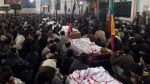 Pakistani Shiite Muslims attend the funeral prayer of the victims of bomb blast at a mosque in Parachinar, the capital of Pakistan's Kurram tribal region, Saturday, Jan. 21, 2017. A bomb exploded in a market in a northwest tribal region that borders Afghanistan, killing more than 20 and wounding dozens. The explosion took place when the market was crowded with retailers buying fruits and vegetables from a wholesale shop, officials said. (AP Photo/Ali Murtaza)