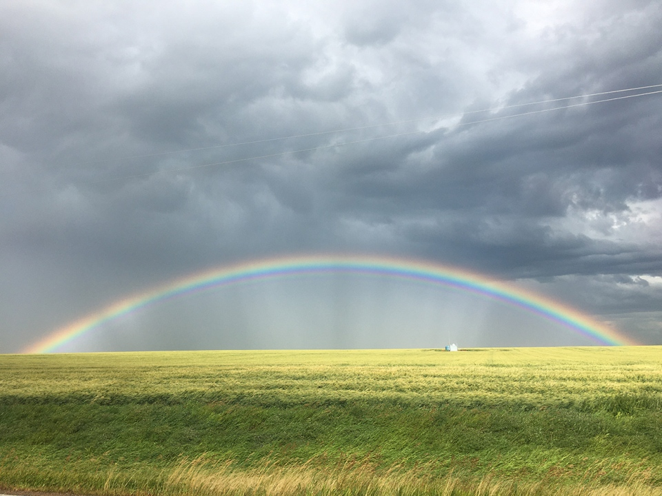 Rainbow, storm clouds, prairies