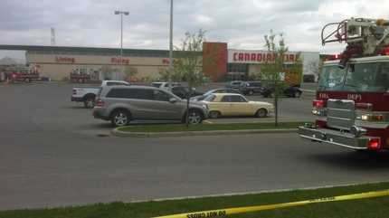 Emergency crews have roped off the area around the store on 126 Ave. S.E.
