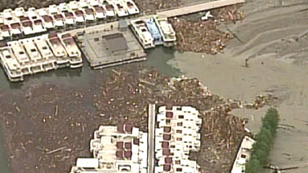 Dozens of houseboats lay scattered among the debris after flooding in B.C.