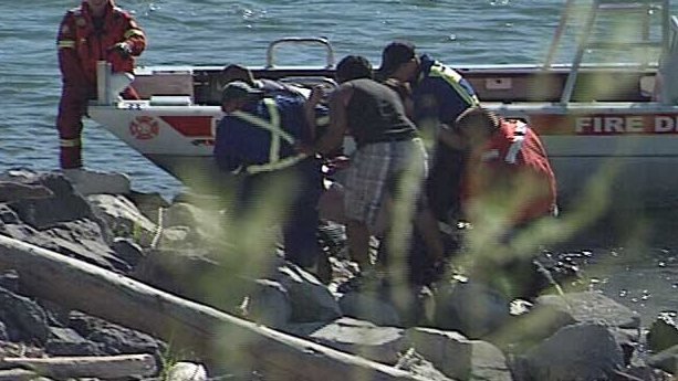 Emergency crews pull the man to shore.