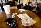A BlackBerry is left on a table at a coffee shop in Montreal in this 2012 file photo. (Paul Chiasson / THE CANADIAN PRESS)