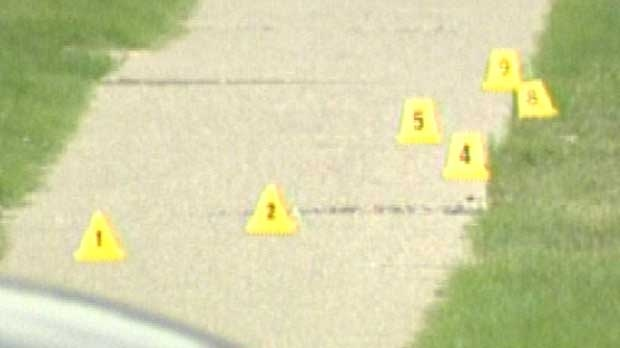 Evidence markers sit on the pavement outside an Acadia home where the body of Josh Hogarth was found.