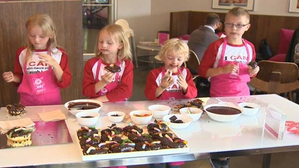 The kids made doughnuts at Jelly Modern Doughnuts to support kids cancer care.